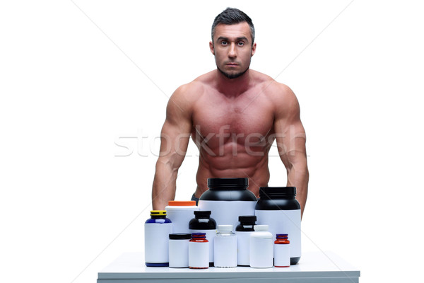 Portrait of a handsome man presenting sports nutrition Stock photo © deandrobot