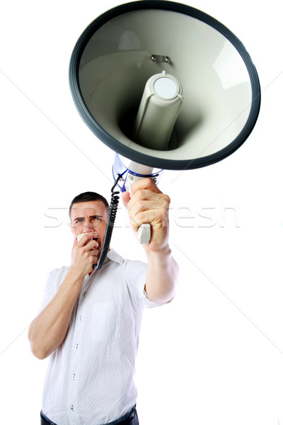 Portrait of a man roaring loudly into megaphone over white background Stock photo © deandrobot
