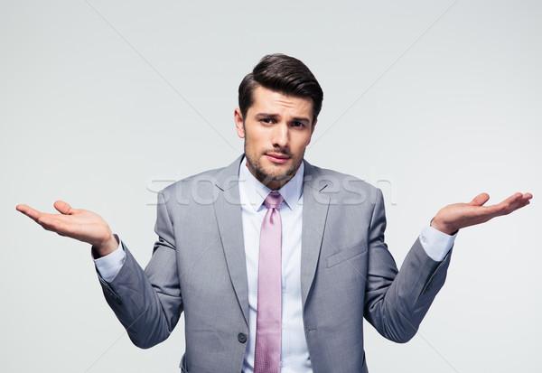 Empresário ombros cinza olhando câmera negócio Foto stock © deandrobot