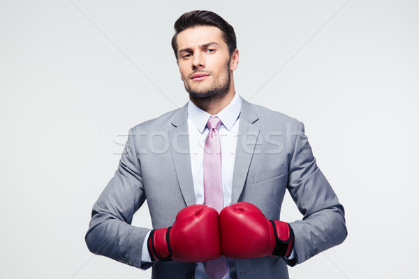 Businessman standing with boxing gloves  Stock photo © deandrobot