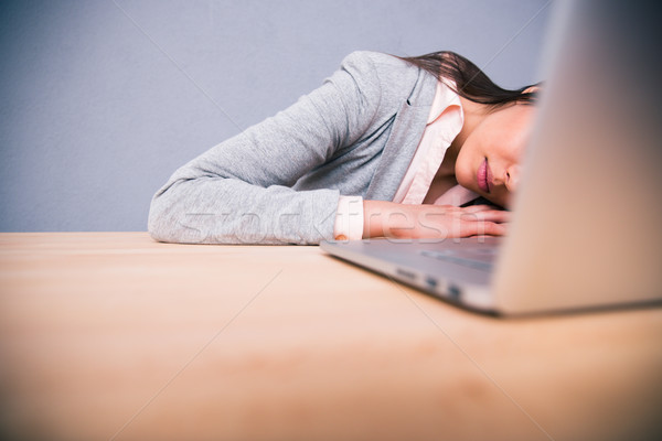 Cute business woman sleeping on the table Stock photo © deandrobot