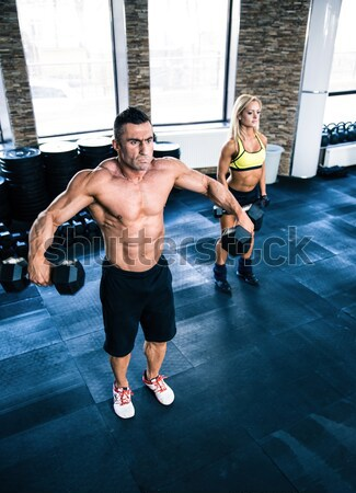 Group of a man and woman workout with fitball Stock photo © deandrobot