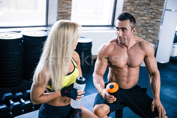 Woman and muscular man talking at gym Stock photo © deandrobot