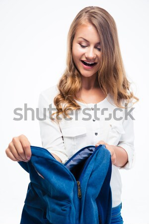 Female student opening her backpack  Stock photo © deandrobot