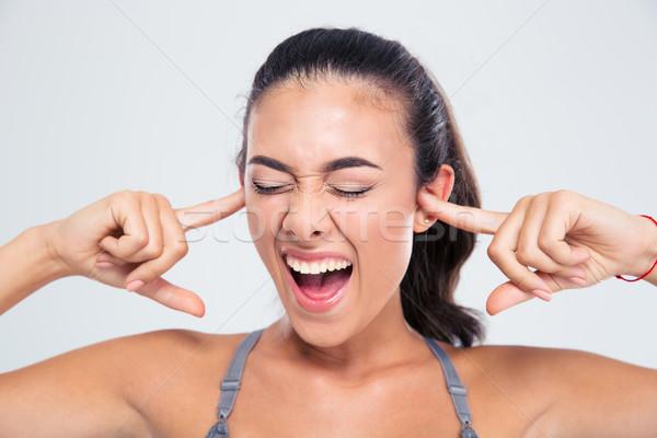 Vrouw oren vingers portret fitness vrouw Stockfoto © deandrobot