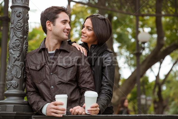 Happy couple flirting outdoors Stock photo © deandrobot