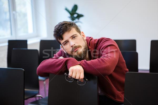 красивый парень глядя исчерпанный борода сидят Сток-фото © deandrobot