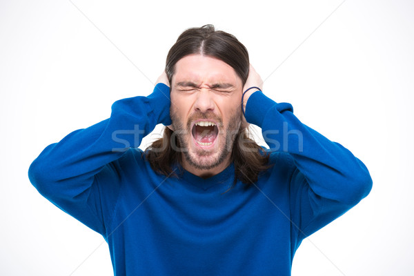 Desperate man closed ears by hands and screaming Stock photo © deandrobot