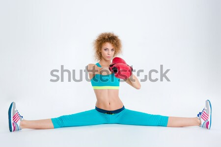 Sports woman sitting on fitness ball Stock photo © deandrobot