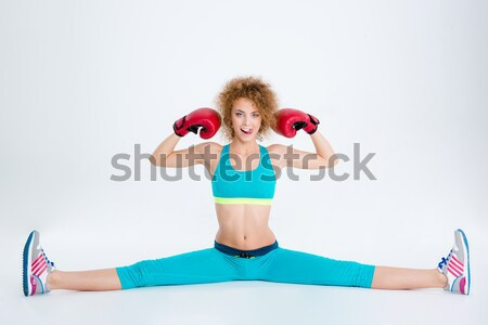 Fitness woman doing twine and showing her biceps  Stock photo © deandrobot