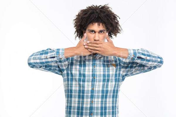 Afro american man covering his mouth with palms Stock photo © deandrobot
