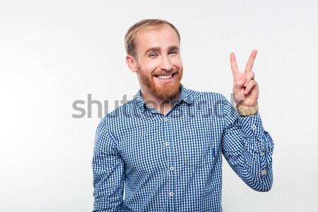 Uśmiechnięty przypadkowy człowiek zwycięstwo podpisania Zdjęcia stock © deandrobot