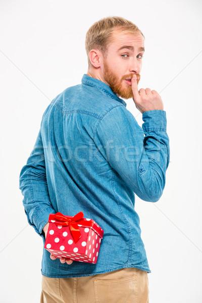 Homem bonito ocultação dom atrás de volta Foto stock © deandrobot