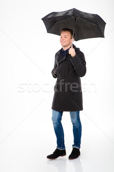 Feliz conteúdo jovem masculino casaco caminhada Foto stock © deandrobot