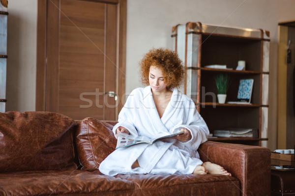 очаровательный женщины диван чтение моде Сток-фото © deandrobot