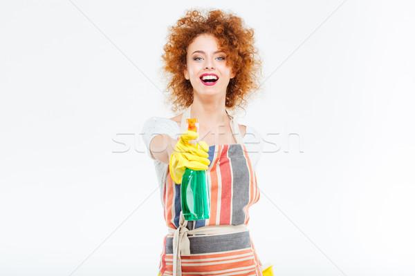 Alegre mulher amarelo luvas spray Foto stock © deandrobot