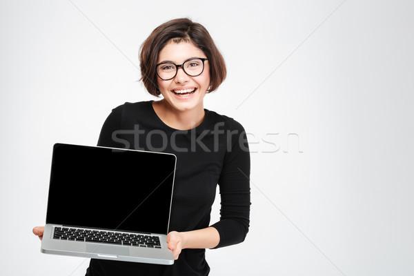Mulher computador portátil tela risonho isolado Foto stock © deandrobot