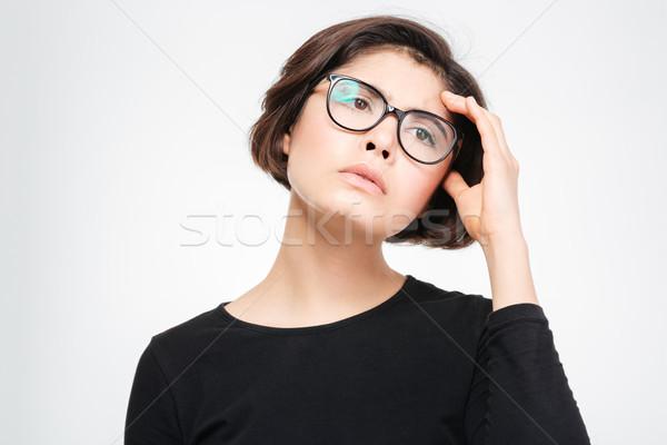 Töprengő nő másfelé néz izolált fehér lány Stock fotó © deandrobot