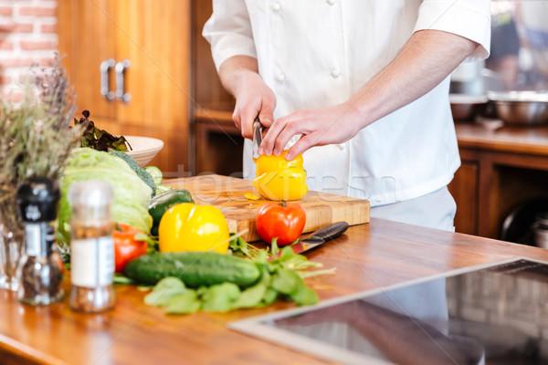 Szakács szakács vág citromsárga paprika konyha Stock fotó © deandrobot