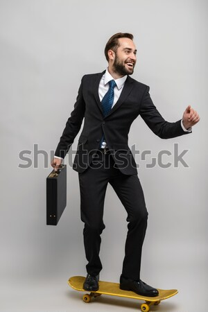 Cheerful young man in tuxedo with bowtie showing ok sign Stock photo © deandrobot