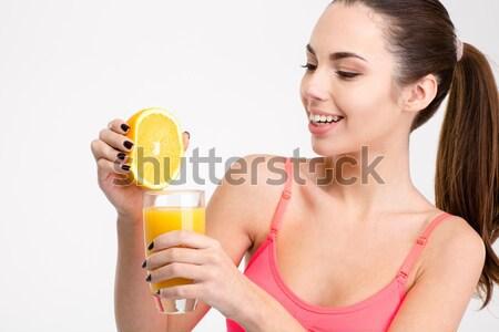 Bild Mädchen bikini Gießen Limonade Glas Stock foto © deandrobot