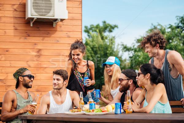 группа друзей питьевой пива еды Сток-фото © deandrobot