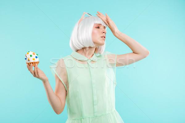 Szomorú zaklatott szőke nő fiatal nő édes minitorta Stock fotó © deandrobot