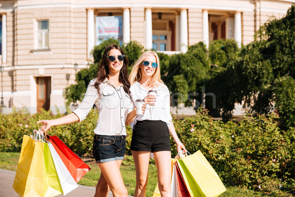 Two happy women with shopping bags Stock photo © deandrobot