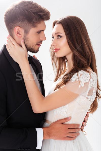 Csinos ifjú pár fehér esküvő pár háttér Stock fotó © deandrobot
