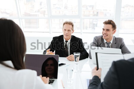Business people in conference room Stock photo © deandrobot