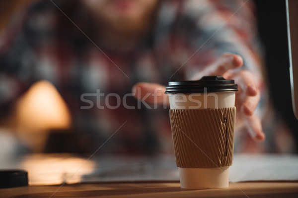 Cropped image designer working at night and tries take coffee Stock photo © deandrobot