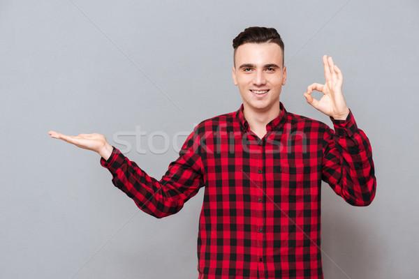 Man in shirt showing ok Stock photo © deandrobot