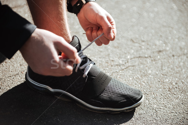 Runner tying shoelaces in park Stock photo © deandrobot