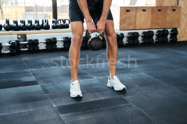 Cropped image of man with weight Stock photo © deandrobot
