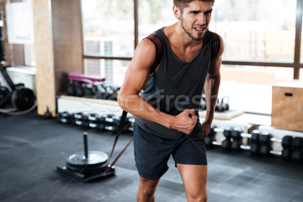 bodybuilder pulling load Stock photo © deandrobot