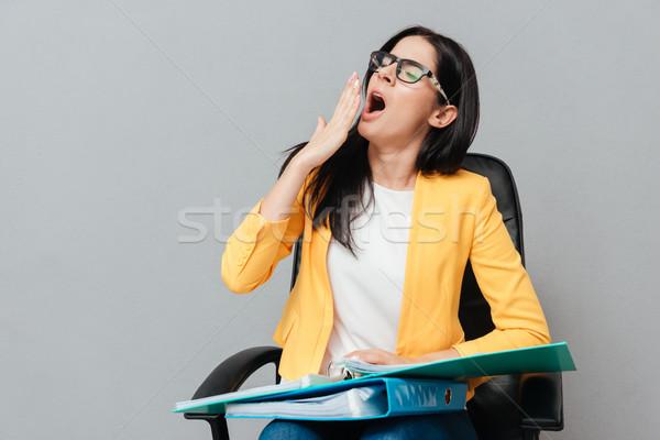 Fáradt nő tart mappák ásít szürke Stock fotó © deandrobot