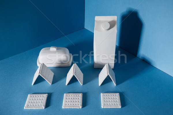 Milk, butter and cookies standing in the corner Stock photo © deandrobot
