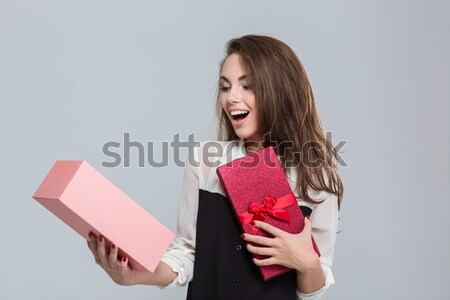 Young woman covering her mouth with book Stock photo © deandrobot