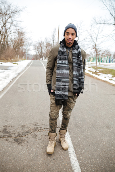 African young man standing on the road outdoors Stock photo © deandrobot