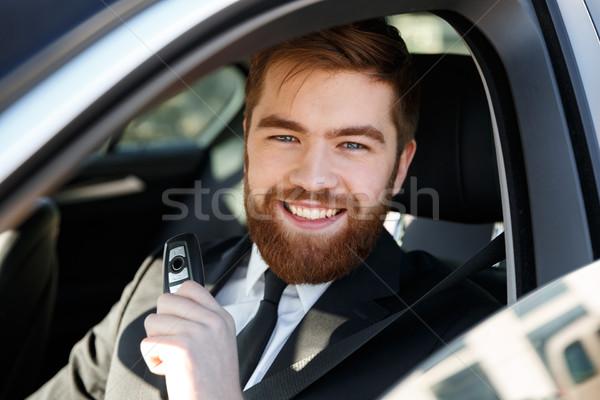 Sonriendo empresario sesión coche coche nuevo Foto stock © deandrobot