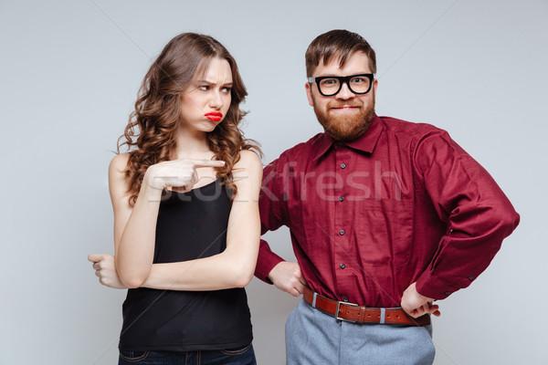 Niezadowolony kobieta funny mężczyzna nerd wskazując Zdjęcia stock © deandrobot