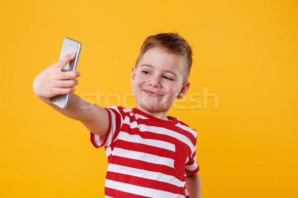 Stockfoto: Glimlachend · weinig · jongen · mobiele · telefoon