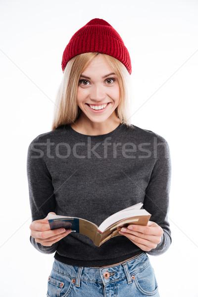 Sorridente mulher jovem livro aberto olhando câmera Foto stock © deandrobot
