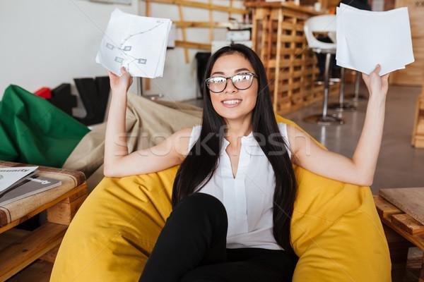 Alegre mulher sessão saco de feijão cadeira Foto stock © deandrobot