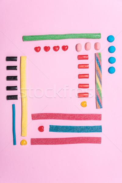 Felső kilátás édes cukor cukorkák csetepaté Stock fotó © deandrobot