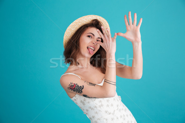 Portrait of a young silly beach girl wearing summer clothes Stock photo © deandrobot