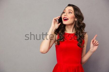 Felice tenero vestito rosso piedi sorridere Foto d'archivio © deandrobot