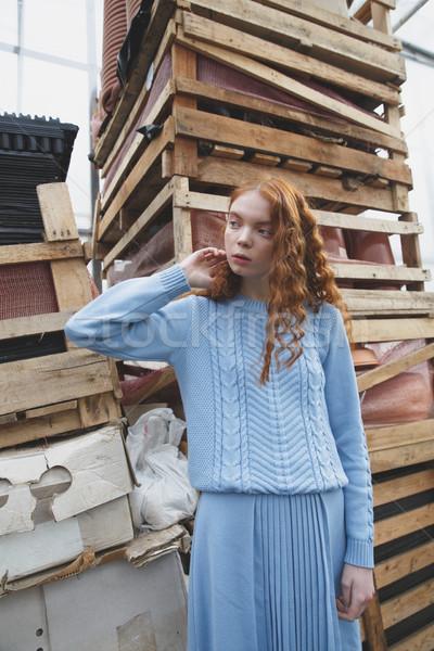 Girl near boxes Stock photo © deandrobot