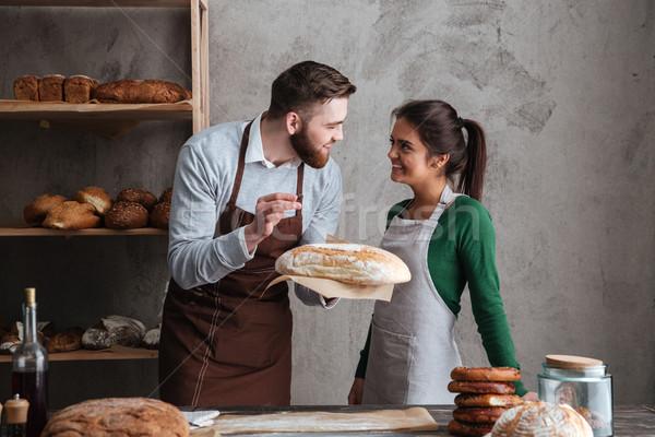 Sonriendo amoroso Pareja pie panadería Foto stock © deandrobot