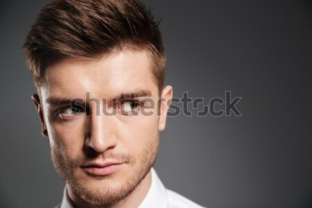 Confident serious man in shirt looking away at copy space Stock photo © deandrobot